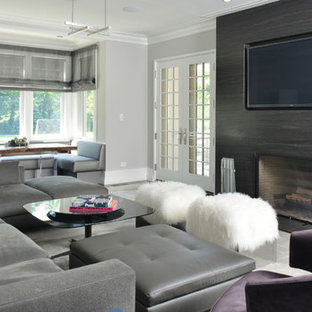 Inspiration for a mid-sized modern open concept gray floor living room remodel in New York with gray walls and a media wall