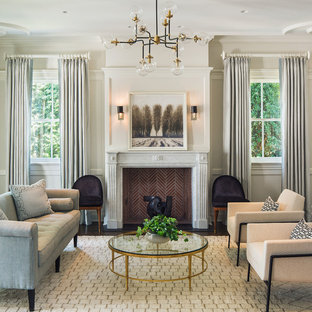 Living room - mid-sized transitional formal and enclosed dark wood floor and brown floor living room idea in New York with white walls, a standard fireplace and no tv