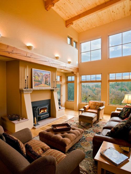 mediterrane wohnzimmer mit orangefarbenen w nden ideen design houzz. Black Bedroom Furniture Sets. Home Design Ideas