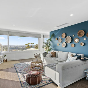 Design ideas for a mid-sized transitional loft-style living room in Geelong with medium hardwood floors.