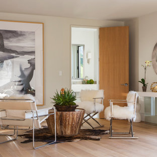 Example of a trendy light wood floor living room design in Los Angeles with gray walls