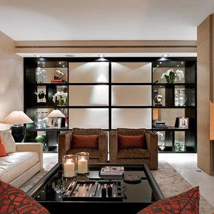 Imagen de salón para visitas cerrado, actual, grande, con paredes beige, televisor colgado en la pared y chimenea de doble cara