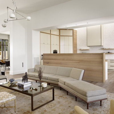 Inspiration for a contemporary open concept living room remodel in Austin with white walls