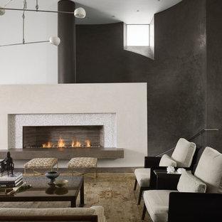 Modelo de salón actual, sin televisor, con paredes negras y chimenea lineal
