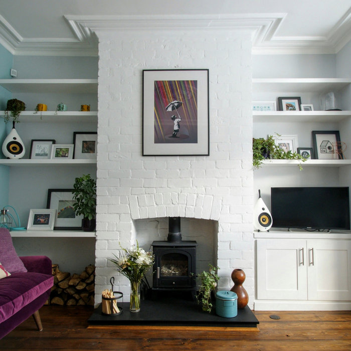 Custom designed floating shelves and shaker style cupboard hand-painted in a brilliant white eggshell finish.   For a Victorian terraced house in Sheffield, near Endcliffe Park.