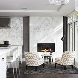 Идея дизайна: парадная, открытая гостиная комната среднего размера в современном стиле с белыми стенами, темным паркетным полом, горизонтальным камином, фасадом камина из камня и коричневым полом без ТВ