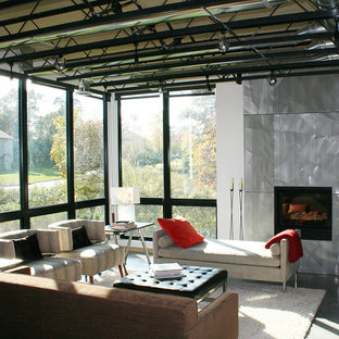 Mid-sized urban open concept and formal concrete floor living room photo in Minneapolis with white walls, a standard fireplace and a metal fireplace
