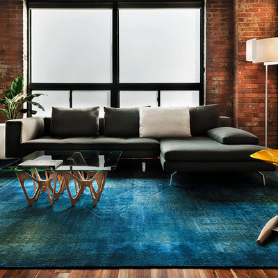Living room - industrial medium tone wood floor living room idea in Denver with no fireplace and no tv