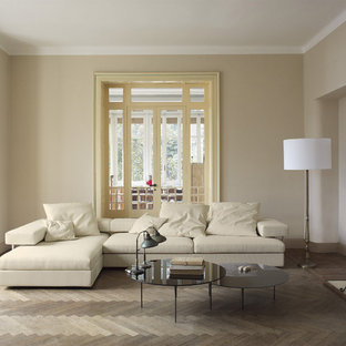 Example of a trendy gray floor living room design in Philadelphia with beige walls and a standard fireplace