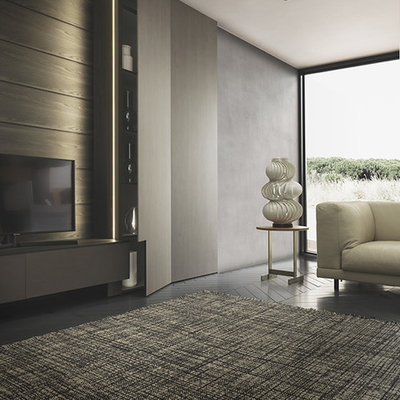 Inspiration for a modern living room remodel in Boston with a media wall