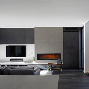 Inspiration for a contemporary living room in Melbourne with white walls, dark hardwood floors, a ribbon fireplace, a wall-mounted tv and grey floor.