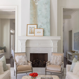 Mid-sized elegant formal and enclosed living room photo in New Orleans with white walls, a standard fireplace, a stone fireplace and no tv