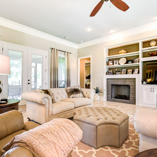 Inspiration for a large traditional open concept living room in New Orleans with beige walls and porcelain floors.