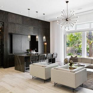 Aménagement d'un salon contemporain avec un mur blanc, un sol beige et un bar de salon.