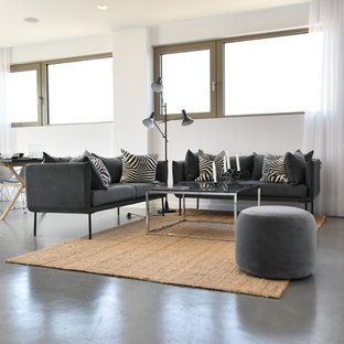 Medium sized modern open plan living room in London with white walls, no tv and grey floors.