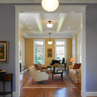 Inspiration for a traditional enclosed living room in DC Metro with a music area, yellow walls and medium hardwood floors.