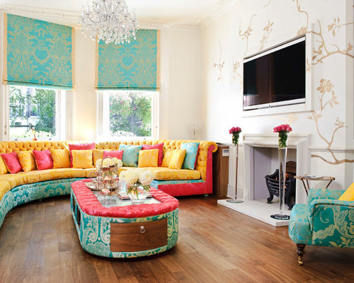 large transitional living room photo in london with beige walls medium tone hardwood floors - Colorful Living Room