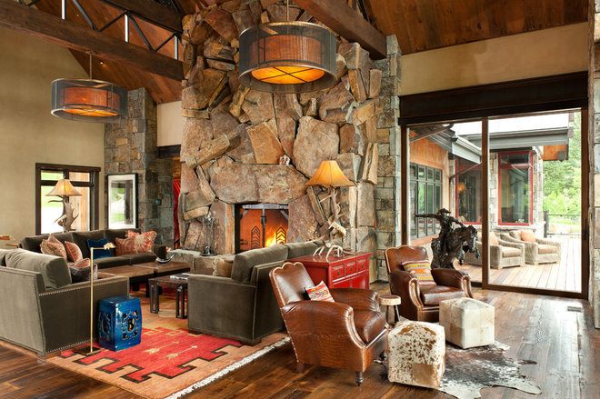 Rustic Living Room by Montana Rockworks, Inc