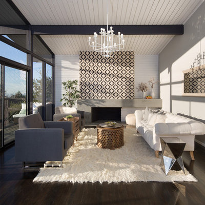 Example of a mid-sized danish open concept and formal dark wood floor and brown floor living room design in San Francisco with a standard fireplace, a concrete fireplace, gray walls and no tv