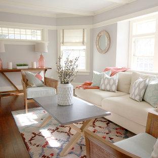 Immagine di un soggiorno chic di medie dimensioni e chiuso con pareti viola, parquet scuro e cornice del camino in mattoni