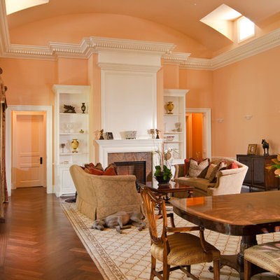 Inspiration for a timeless formal and open concept medium tone wood floor living room remodel in San Francisco with pink walls, a standard fireplace and no tv