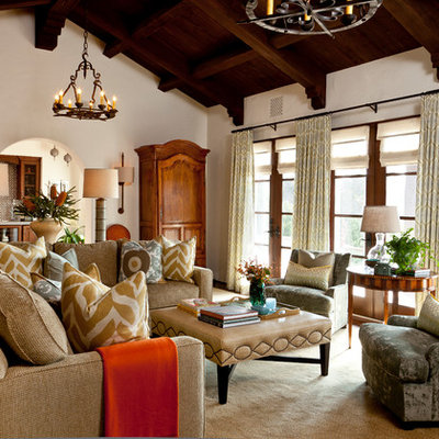 Mid-sized tuscan enclosed dark wood floor living room photo in Santa Barbara with beige walls, no fireplace and no tv