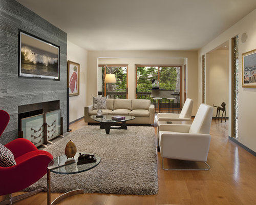Example of a trendy enclosed living room design in Santa Barbara with beige walls