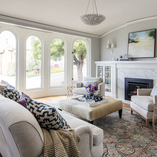 Living room - mid-sized transitional medium tone wood floor and brown floor living room idea in San Francisco with gray walls and a standard fireplace