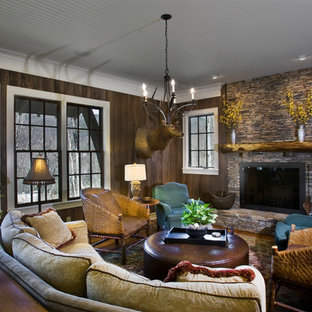 Photo of a medium sized rustic open plan living room in Other with brown walls, dark hardwood flooring, a standard fireplace and a stone fireplace surround.