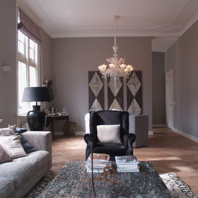 Example of a trendy living room design in Amsterdam with gray walls
