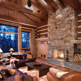 Medium sized rustic formal open plan living room in Other with light hardwood flooring, a stone fireplace surround and brown walls.