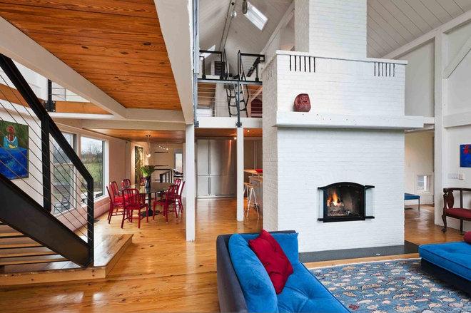 Farmhouse Living Room by Sandvold Blanda Architecture + Interiors LLC