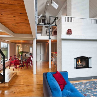 Inspiration for a farmhouse living room remodel in Philadelphia with a brick fireplace