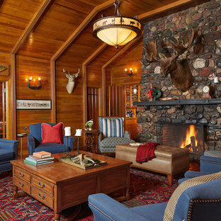 Photo of a medium sized rustic formal open plan living room in Minneapolis with a standard fireplace, a stone fireplace surround, brown walls, carpet, no tv and red floors.