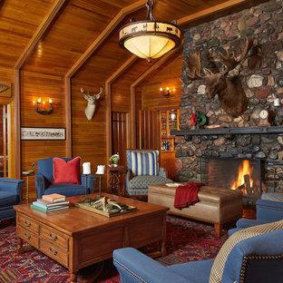 Esempio di un soggiorno rustico di medie dimensioni e aperto con sala formale, camino classico, cornice del camino in pietra, pareti marroni, moquette, nessuna TV e pavimento rosso
