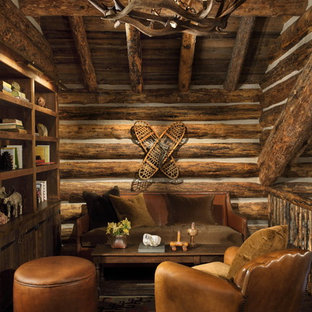 Living room library - rustic living room library idea in Other with no tv