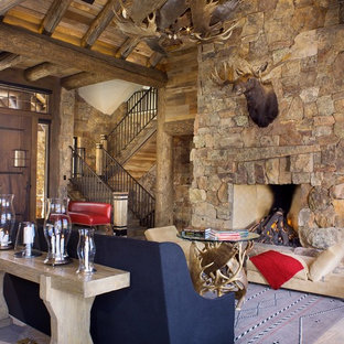 Example of a mid-sized mountain style formal and open concept gray floor living room design in Denver with a standard fireplace, a stone fireplace, brown walls and a wall-mounted tv