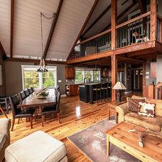 Rustic Living Room by Yankee Barn Homes