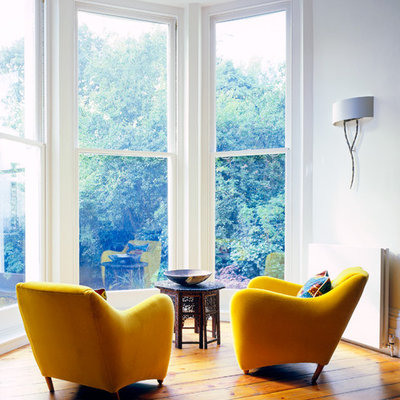 Danish living room photo in New York with white walls
