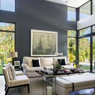 Ispirazione per un grande soggiorno design aperto con sala formale, pareti bianche, pavimento in pietra calcarea e pavimento beige