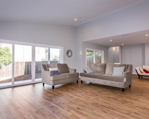 Soggiorno moderno con pavimento in laminato - Foto, Idee, Arredamento