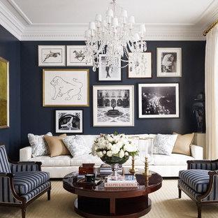 На фото: парадная гостиная комната в классическом стиле с черными стенами, ковровым покрытием и бежевым полом без камина с
