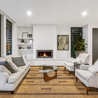 Inspiration for a mid-sized contemporary open concept and formal light wood floor and beige floor living room remodel in Sydney with white walls, a ribbon fireplace and a plaster fireplace