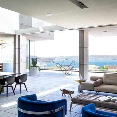 Living room - contemporary open concept gray floor living room idea in Sydney with multicolored walls