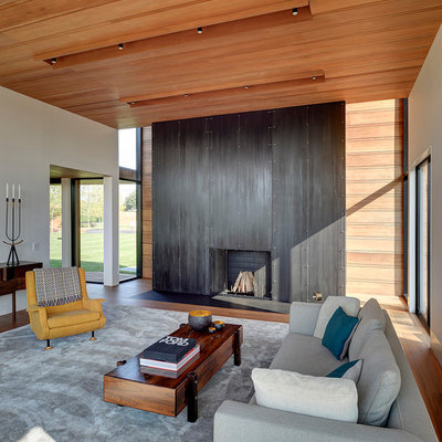 Inspiration for a modern formal and open concept medium tone wood floor living room remodel in New York with white walls, a standard fireplace and a metal fireplace