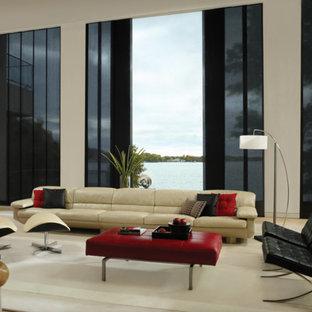 Diseño de salón para visitas cerrado, minimalista, grande, sin chimenea y televisor, con paredes beige, suelo de travertino y suelo beige
