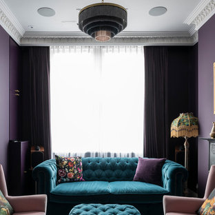 Photo of a classic formal living room in London with purple walls and no tv.