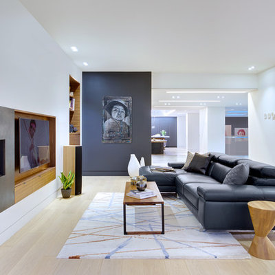 Living room - scandinavian open concept and formal light wood floor living room idea in Toronto with white walls, a ribbon fireplace, a metal fireplace and a media wall