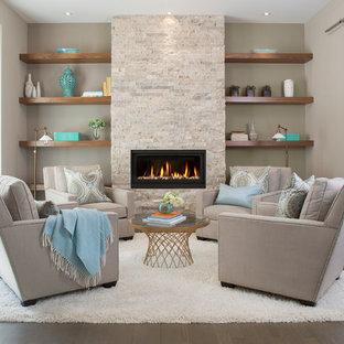 Cette image montre un salon traditionnel de taille moyenne et fermé avec un mur gris, un sol en vinyl, une cheminée standard et un manteau de cheminée en pierre.