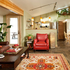 Rustic Living Room by Mindful Designs, Inc.